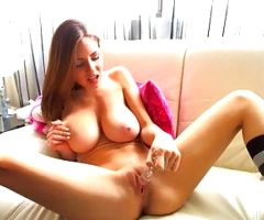 busty brunette rubs her pussy with dildo