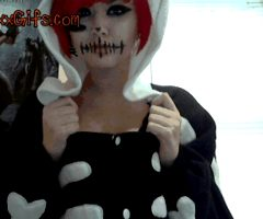 Halloween red head chick shows her small tits