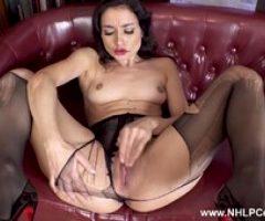 Horny brunette rips pantyhose masturbates in high heels