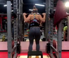MMA Fighter Aleksandra Albu Squatting