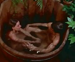 Redhead girl blows a cock on wooden tub