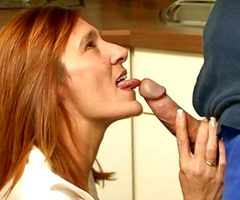 Redhead housewife takes a fucking in her kitchen