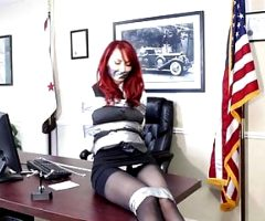 Senator Kendra James tied up and gagged with tape