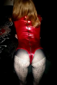 Shiny Red On Red In Bed.
